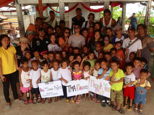 "The beneficiaries of ""Bag to School"" project pose with TMA Bulig volunteers  held at Jose Aninang Sr. Primary School, Nagurang Island, Milagros, Masbate"