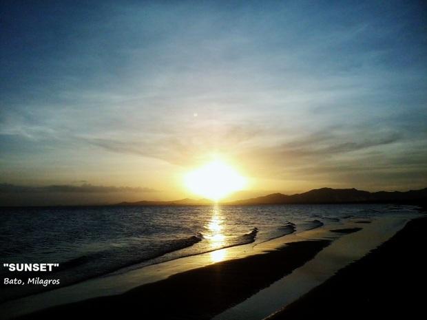 "SUNSET"" By: Melrose Rebaya An paglubog san adlaw hali sa pinakasikat na kariguan san Milagros.  Bato, Milagros  January 1, 2013 Panel of Judges - 35% Likes - 44% Ave = 79% Prize - P500.00"
